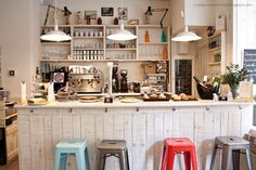 what a quirky and adorable kitchen/coffeehouse! this kind of kitchen setting would be perfect for hanging out the roommates :)
