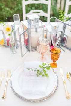 gold and silver place setting with bright florals #weddingreception #tabledecor #weddingchicks http://www.weddingchicks.com/2014/02/17/feel-good-floral-wedding-ideas/