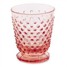 """Vintage Hobnail Tumbler Pink - When the weather turns warmer we love entertaining outdoors, and our new hobnail tumbler adds an easy elegance to any affair. We love how its rich colour and textured shape sparkle on a sunny day. Mix and match them in a rainbow of luminous colours for a chic and unexpected setting. Glass. Dishwasher safe. Do not microwave. 8 oz. capacity, 3.75"""" high"""
