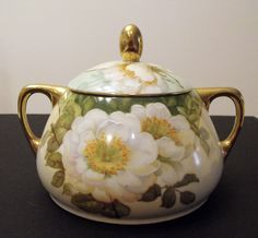Antique Royal Rudolstadt Prussia Biscuit Cracker Jar with White Roses by Beyer and Bock Company 1905 to 1920. via Etsy.
