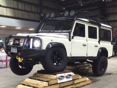 Land Rover Defender on articulation ramps @ Rover Landers Founders Day show 2015