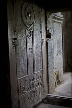 Old Armenian door at the 8th century Tatev monastery. Traditional Armenian symbols and a rich culture of wood carving.