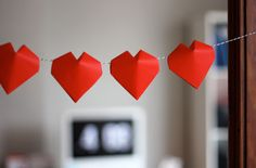 What a sweet garland! 3D origami hearts tutorial | How About Orange