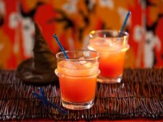 Witches' Brew Cocktail -   2 oz mixed pineapple and cranberry juices, 1 1/4 oz shot Malibu Coconut rum, 2 oz 7 Up.  Mix juices and 7-Up in a highball glass. Pour shot down the side of the glass right before drinking.