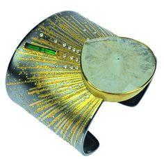 atelier zobel - solaris quartz, emeralds, champagne colored diamonds