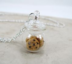 Chocolate Chip Cookie Jar Necklace Miniature Food Jewelry. $24.75, via Etsy.
