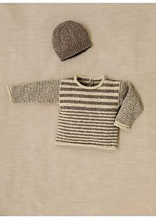 This sweater is made from ECOTON yarn (48% recycled cotton - 48% recycled acrylic - 4% other fibres). It is knitted in striped stocking stitch and garter stitch on 3 mm and 3.5 mm needles. You'll also need some 3.5 mm double-pointed needles so that you don't have to keep cutting off the yarn when knitting the stripes. The pattern is easy to make and perfect for learning how to change colour, while an invisible shoulder opening fastened with press-studs, means it's easy to slip over baby's…