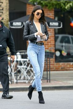 Kendall Jenner street style with leather jacket and denim jeans (December 2016).