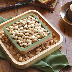 Pistachio Pedestal ($48.00) - This solid wood pistachio server is designed to offer an elegant solution for storing discarded shells.