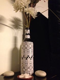 Stick lace on an empty wine bottle and beautify