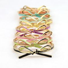 Bow bracelet bangles by LuELsDecor on Etsy https://www.etsy.com/listing/205160275/bow-bracelet-bangles