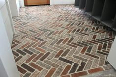 Thinking about putting a brick floor in your home? Read this post for information about where to buy brick tiles, cost, sealer, and more! Foyer Flooring, Brick Flooring, Floors, Kitchen Flooring, Kitchen Cabinets, Kitchen Reno, Laminate Flooring, Brick Tile Floor, Brick Pavers