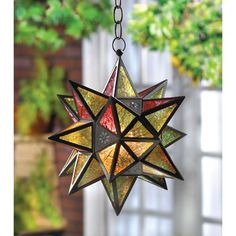 Moroccan-Style Star Lantern from Koehlerhomedecor.com  The Moroccan star is the inspiration for this multicolored lantern. Insert a tealight or votive to set the jewel-tone panels aglow! Metal with glass panels.  Buy wholesale at Koehler Home Décor.