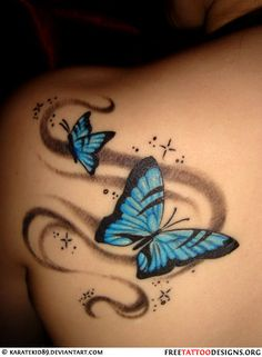 Butterfly and stardust tattoo on a woman's shoulder