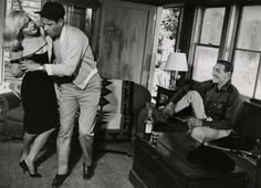 """Marilyn Monroe and Eli Wallach dance while Clark Gable looks on. Photographed by Inge Morath on the set of """"The Misfits"""" (1960)."""