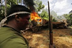 13 Incredible Photos of Amazon Tribe Fighting Back Against Illegal Loggers