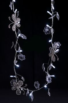 LED Battery Operated String Lights with Butterflies & Crystals. These would be cool to have if I get the more elaborate dress because they sort of match the design on it. Battery Operated String Lights, Cheap Candles, Gold Color Scheme, Globe String Lights, Light Garland, Save On Crafts, Floral Supplies, Crystal Flower, Fairy Lights