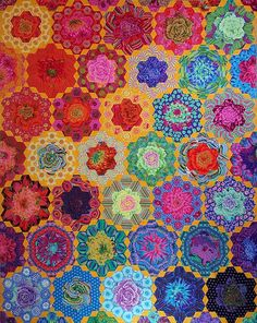Quilt by Ann Zemke. Handstitched hexie quilt from Kaffe Fassett fabric.