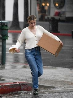 Make it rain: The actress was snapped in an off-white flowing cardigan as she made her way through the downpour Rain Street, Make It Rain, 27 Years Old, Emma Roberts, Old Actress, Off White, Normcore, Street Style, Style Inspiration