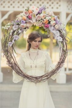 Floral wedding wreath for decor or photo booth and vintage bridal look. Floral Design: Recycled Love Story #weddingchicks http://www.weddingchicks.com/2014/06/16/these-vintage-dresses-will-captivate-your-romantic-side/