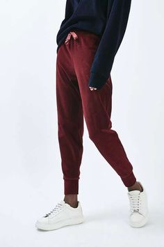 Keep your loungewear luxe in these navy burgundy velour joggers with grosgrain drawcord detail. Wear with a matching hoodie and clean white trainers for a laid back look. #Topshop