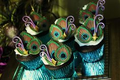 peacock cupcakes!  omg....i so wished i would of known about this pinterest thing before my wedding....there is so much peacock stuff on here.  :)