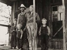 A farmer and his family pose outside their home in the Ozark mountains in Missouri, May 1940, for John Vachon's camera