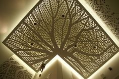 Plywood suspended ceiling. Tree pattern milled.