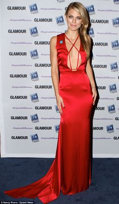 Lady in red: The former 90210 star wore her blonde hair to one side in soft waves