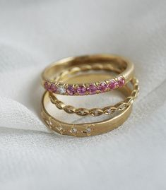Feminine, artistic and celestial, the Satine Stack surprises with sparkling sapphires and organic shapes. Torn paper edges of matte gold and etched star shapes glitter with diamonds creating a subtle sparkle perfect for everyday wear. Beautiful on their own but even better together, these stacking rings create a mystical chic look we adore!