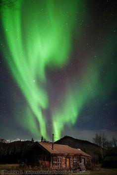 Aurora borealis and log cabin in Wiseman, Alaska.