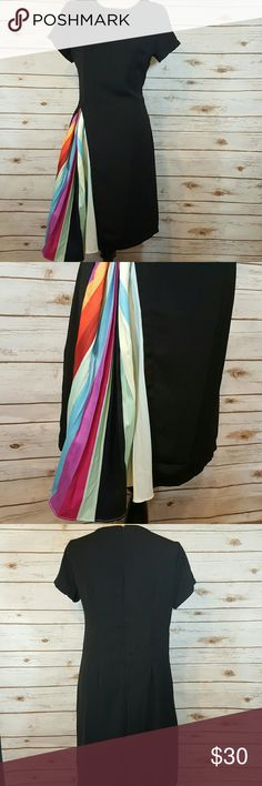 """Peak-a-boo pleats black dress Minimalistic black shift dress with Peak-a-boo rainbow accordian pleats. Pleats need to be ironed or left as is. Bust- 38"""" Waist- 34"""" Hips- 40"""" (pleats add inches, too) Length- 37"""" No stretch. 65% cotton, 35% polyester. Tag says XL, runs small. Dresses"""