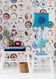 Lord knows I love plates on walls (I aspire to old lady decor), but it never occurred to me to make the plates look like an all-over pattern!  Genius!  (Credit - RICE Autumn 2011)