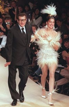 Yves Saint Laurent: Yves Saint-Laurent with Laetitia Casta at the end of his Spring 2000 Couture collection in January 2000.