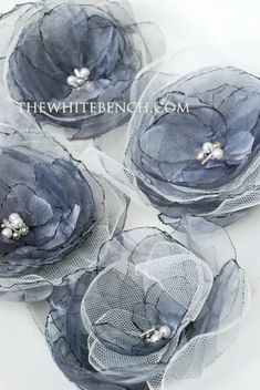 I love these in the grey/silver color!  Organza Flowers Tutorial  by Monica at The White Bench Blog.