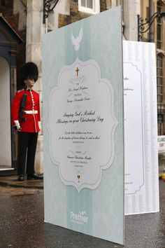 A giant christening card, signed by 5,000 Christians, for Prince George and the royal family is seen outside Chapel Royal, St James's Palace...