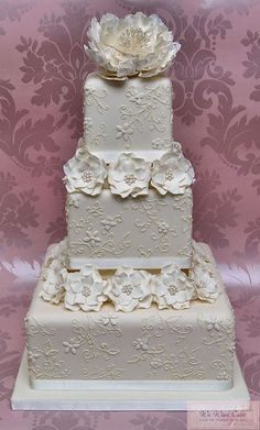Ivory lace and peony wedding cake