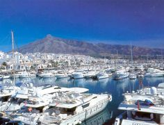 "Puerto Banus is situated between the towns of Marbella and Estepona on the Costa del Sol in Spain and lies in an almost idyllic setting with ocean views and an impressive mountain backdrop. Until 20 years ago it was an exclusive port and marina only known to a few discerning holiday makers. Today it has grown into a popular holiday resort and 'party port' for the rich and famous where the lifestyle is ""to see and be seen""."
