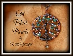 Beautiful tree of life pendant / necklace with lovely glass beads and hematite colored wire for the tree. By Kimi Springer of Son Blest Beads http://www.ebay.com/sch/sonblestbeads/m.html?item=281167463243&pt=Handcrafted_Artisan_Jewelry&hash=item4176e3034b&rt=nc&_trksid=p2047675.l2562
