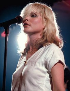 """Pictured here is Debbie Harry, better known as """"Blondie,"""" on stage back in The iconic new wave singer is also considered the first female rapper to chart at number one in the United States because of her work on Rapture. Blondie Debbie Harry, Debbie Harry Hot, Women Of Rock, Female Singers, Gi Joe, Rock And Roll, Beautiful Women, Actresses, Bands"""