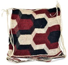 Bolivian Twined Bag. This handsome shoulder bag is made with a bromeliad fiber which is currently cultivated by the Ayoreo women of  the Puesto Paz community in Bolivia. Each bag is unique and patterns vary from bag to bag. The bags are traditional and represent the seven clans of the Ayoreo indigenous people. $140.00 || ClothRoads.com