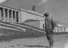 An American soldier stands before the Zeppelinhaupttribüne (grandstand) southeast of Nuremberg, Germany, 1945 Ww2 History, History Photos, Nuremberg Rally, Nuremberg Germany, Fascist Architecture, Army Day, The Third Reich, Korean War, World War One
