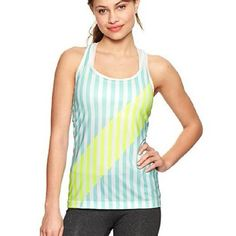 GAP Stripe Racerback Tank Top NWT $29 XS High performance breathable tank keeps you cool during workouts. Pulls moisture away from skin to keep you dry. Flatlocked seams create fluid lines & prevent s. Scoop neckline, striped pattern with wide diagonal in front. Slim silhouette Fits close to body. Hits below the hip. Pic #2 shows the back in a different color - it's there only to show what back looks like. NWT XS  BUNDLE DISCOUNT:  GET 20% OFF 3 ITEMS GAP Tops Tank Tops