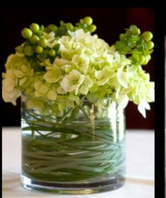 Small vases. Simple hydrangea and pink Hypericum.