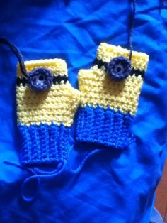 Crochet minion fingerless gloves. Child size. All sizes available. Glove Pattern by two little C's on ravelry.com color changes for minion I made myself