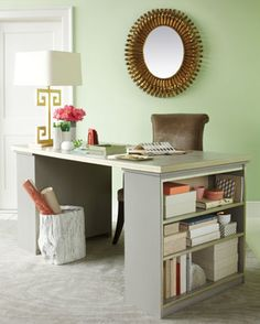 """Create your dream desk by attaching a door for the desk top to open bookcases for the legs! Paint it the color(s) of your choice and display books, baskets and accessories on the open shelving (via Martha Stewart)."""
