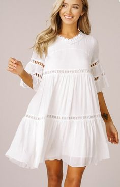 The White Linen Night bell-sleeve Babydoll Dress has a flirty flowy shape of tiered ruffles with peek-a-boo hemline. - Lined - Lace Trim - Length Bell Sleeves - V-NeckBell sleeves ruffle babydoll dress - Rayon crinkle fabric - V-neck - bell sleeves - Simple Dresses, Casual Dresses For Women, Cute Dresses, Short Dresses, Dresses With Sleeves, Maxi Dresses, White Dress With Sleeves, Casual Summer Dresses, Summer Outfits