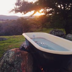 Outdoor bathtub with a fire underneath