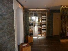 Verkosten Sie in der Vinothek unsere Weine aus eigenem Weingut und die dort angebotenen kleinen Köstlichkeiten. Hotel Berg, Restaurant, Divider, Room, Furniture, Home Decor, Basement, Bedroom, Decoration Home