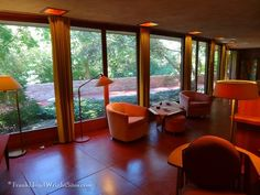 Floor to ceiling windows looking out to the koi pond and patio